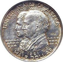 Серебряная монета с изображением Уильяма Бибба и Томаса Килби