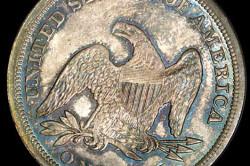 Реверс доллара с сидящей свободой